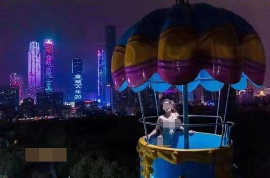女模特在儿童公园跳伞塔拍不雅照 运营方:已报案 百度热搜 图1